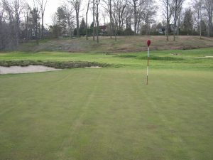 golf green with bunker and flag at Merion